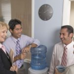 Businesspeople gathering at water cooler