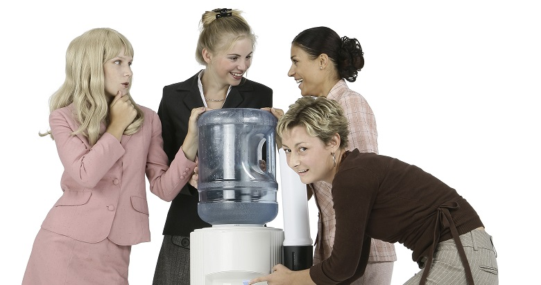 Businesswoman Spying on Water Cooler Conversation